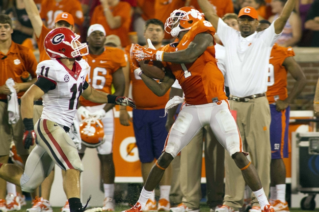 Aug 31, 2013; Clemson, SC, USA; Clemson Tigers wide receiver Martavis Bryant (1) tries to bring in a pass while being defended by Georgia Bulldogs safety Connor Norman (11) during the fourth quarter at Clemson Memorial Stadium. Clemson defeated Georgia 38-35. Mandatory Credit: Jeremy Brevard-USA TODAY Sports