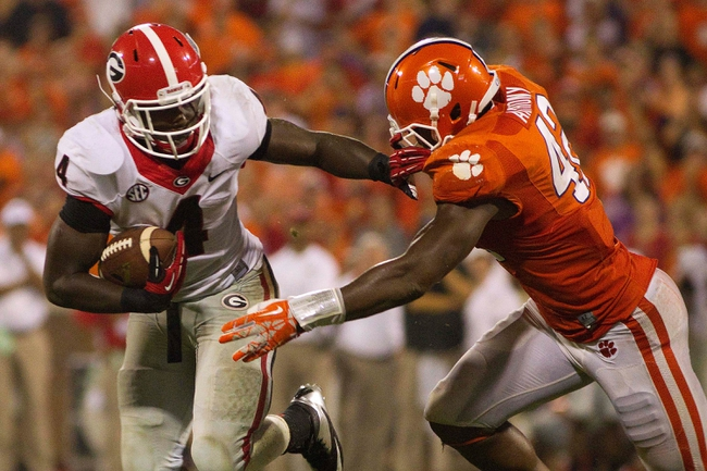 Aug 31, 2013; Clemson, SC, USA; Georgia Bulldogs running back Keith Marshall (4) carries the ball while being defended by Clemson Tigers linebacker Stephone Anthony (42) during the fourth quarter at Clemson Memorial Stadium. Tigers won 38-35. Mandatory Credit: Joshua S. Kelly-USA TODAY Sports