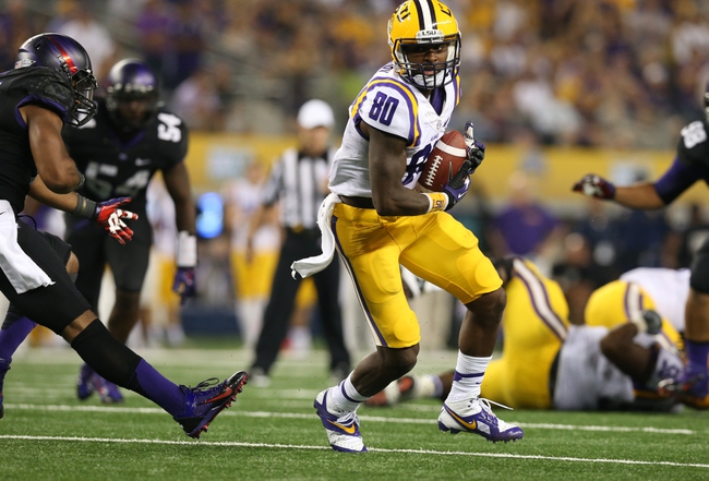 Aug 31, 2013; Arlington, TX, USA; LSU Tigers receiver Jarvis Landry (80) catches a touchdown pass against Texas Christian Horned Frogs safety Chris Hackett (1) in the fourth quarter at AT&T Stadium. Mandatory Credit: Matthew Emmons-USA TODAY Sports