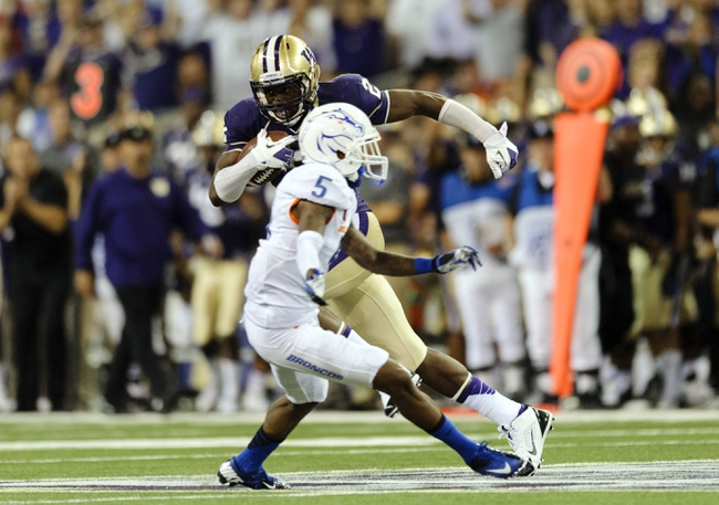 Aug 31, 2013; Seattle, WA, USA; Washington Huskies wide receiver Kasen Williams (2) carries the ball past Boise State Broncos cornerback Donte Deayon (5) during the 2nd half at Husky Stadium. Washington defeated Boise State 38-6. Mandatory Credit: Steven Bisig-USA TODAY Sports