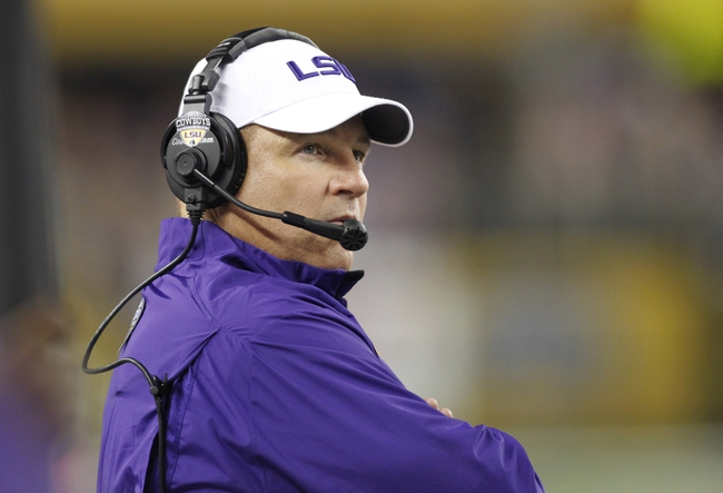 Aug 31, 2013; Arlington, TX, USA; LSU Tigers head coach Les Miles watches the scoreboard during the fourth quarter of the game against the TCU Horned Frogs at Cowboys Stadium. LSU Tigers beat TCU Horned Frogs 37-27. Mandatory Credit: Tim Heitman-USA TODAY Sports