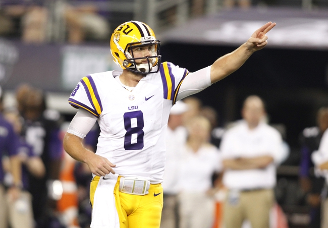 Aug 31, 2013; Arlington, TX, USA; LSU Tigers quarterback Zach Mettenberger (8) signals first down in the fourth quarter of the game against the TCU Horned Frogs at Cowboys Stadium. LSU Tigers beat TCU Horned Frogs 37-27. Mandatory Credit: Tim Heitman-USA TODAY Sports