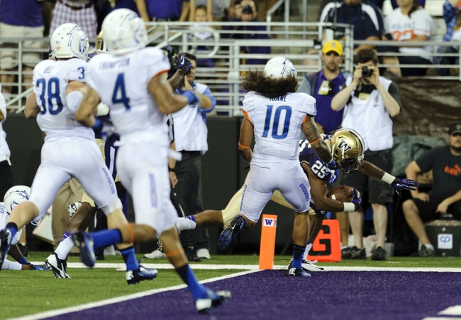 Aug 31, 2013; Seattle, WA, USA; Washington Huskies running back Bishop Sankey (25) dives in for a touchdown against the Boise State Broncos during the 2nd half at Husky Stadium. Washington defeated Boise State 38-6. Mandatory Credit: Steven Bisig-USA TODAY Sports