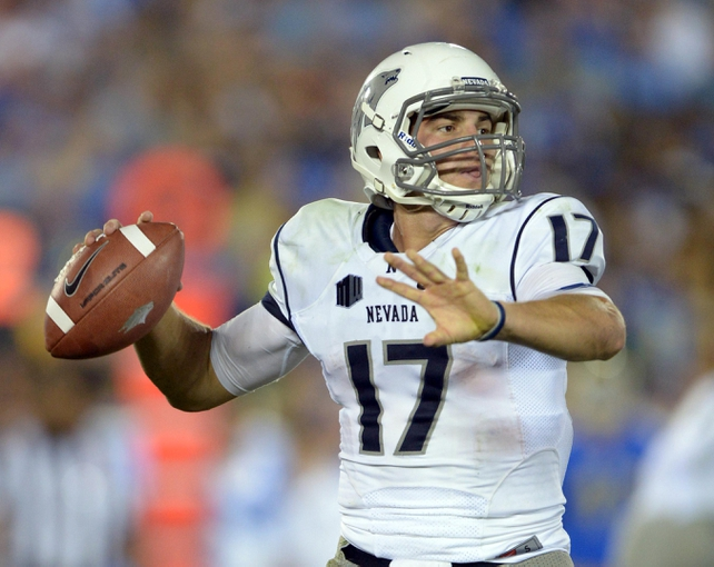 Aug 31, 2013; Pasadena, CA, USA; Nevada Wolf Pack quarterback Cody Fajardo (17) throws a pass against the UCLA Bruins at the Rose Bowl. UCLA defeated Nevada 58-20. Mandatory Credit: Kirby Lee-USA TODAY Sports