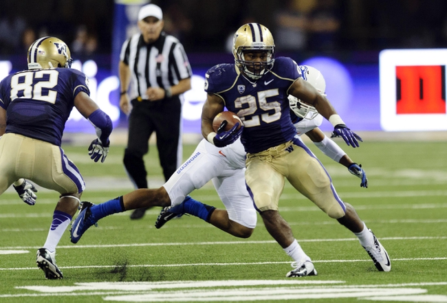Aug 31, 2013; Seattle, WA, USA; Washington Huskies running back Bishop Sankey (25) carries the ball against the Boise State Broncos during the game at Husky Stadium. Washington defeated Boise State 38-6. Mandatory Credit: Steven Bisig-USA TODAY Sports