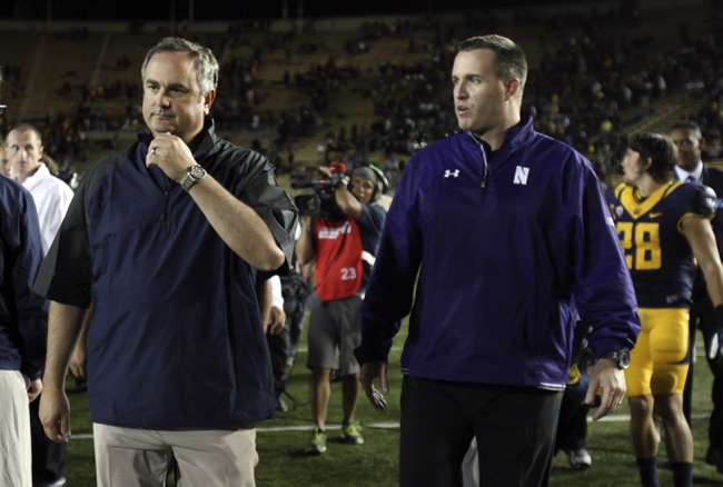 Aug 31, 2013; Berkeley, CA, USA; Northwestern Wildcats head coach Pat Fitzgerald speaks to California Golden Bears head coach Sonny Dykes as he leaves the field after the game at Memorial Stadium. Northwestern won 44-30. Mandatory Credit: Kelley L Cox-USA TODAY Sports