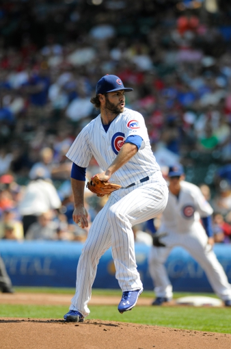Sep 1, 2013; Chicago, IL, USA; Chicago Cubs starting pitcher Jake Arrieta (49) delivers a pitch during the first inning against the Philadelphia Phillies at Wrigley Field. Mandatory Credit: Reid Compton-USA TODAY Sports