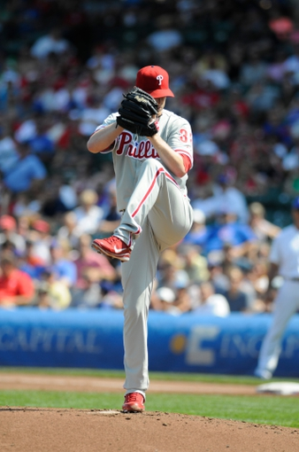 Sep 1, 2013; Chicago, IL, USA; Philadelphia Phillies starting pitcher Kyle Kendrick (38) delivers a pitch during the first inning against the Chicago Cubs at Wrigley Field. Mandatory Credit: Reid Compton-USA TODAY Sports