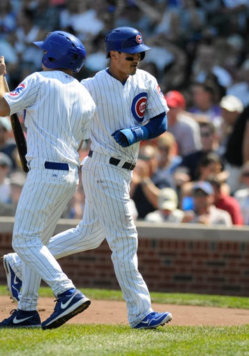 Sep 1, 2013; Chicago, IL, USA; Chicago Cubs second baseman Darwin Barney (15) is congratulated after scoring on an RBI single by center fielder Ryan Sweeney (not pictured) during the first inning against the Philadelphia Phillies at Wrigley Field. Mandatory Credit: Reid Compton-USA TODAY Sports