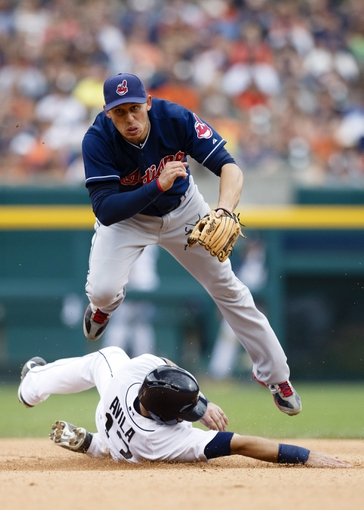 Sep 1, 2013; Detroit, MI, USA; Cleveland Indians shortstop Asdrubal Cabrera (13) forces out Detroit Tigers catcher Alex Avila (13) and throws to first base in the seventh inning at Comerica Park. Mandatory Credit: Rick Osentoski-USA TODAY Sports