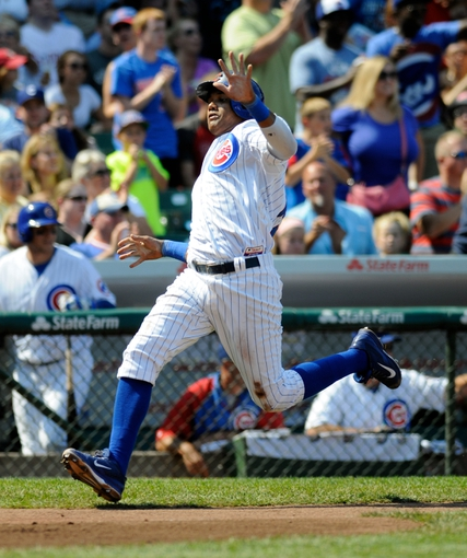 Sep 1, 2013; Chicago, IL, USA; Chicago Cubs shortstop Starlin Castro (13) heads home on an RBI double by first baseman Anthony Rizzo (not pictured) during the third inning against the Philadelphia Phillies at Wrigley Field. Mandatory Credit: Reid Compton-USA TODAY Sports