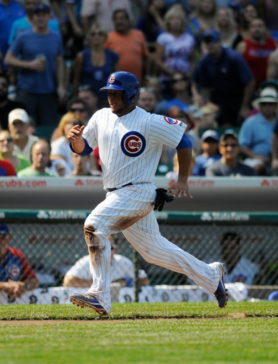 Sep 1, 2013; Chicago, IL, USA; Chicago Cubs catcher Welington Castillo (53) runs home during the fourth inning against the Philadelphia Phillies at Wrigley Field. Mandatory Credit: Reid Compton-USA TODAY Sports