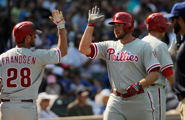 Sep 1, 2013; Chicago, IL, USA; Philadelphia Phillies first baseman Darin Ruf (18) is congratulated by second baseman Kevin Frandsen (28) after hitting a solo home run during the fourth inning against the Chicago Cubs at Wrigley Field. Mandatory Credit: Reid Compton-USA TODAY Sports