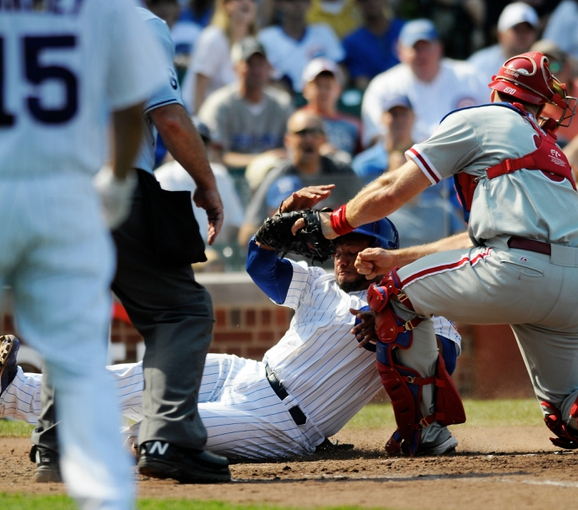 Sep 1, 2013; Chicago, IL, USA; Chicago Cubs catcher Welington Castillo (53) is safe at home plate during the fourth inning against the Philadelphia Phillies at Wrigley Field. Mandatory Credit: Reid Compton-USA TODAY Sports