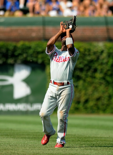 Sep 1, 2013; Chicago, IL, USA; Philadelphia Phillies shortstop Jimmy Rollins (11) catches a fly ball during the fourth inning against the Chicago Cubs at Wrigley Field. Mandatory Credit: Reid Compton-USA TODAY Sports