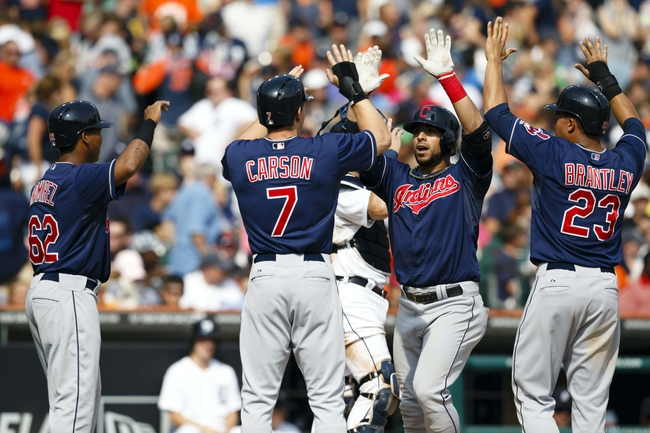 Sep 1, 2013; Detroit, MI, USA; Cleveland Indians third baseman Mike Aviles (4) receives congratulations from teammates Matt Carson (7) , Michael Brantley (23) and Jose Ramirez after he hits a grand slam home run in the ninth inning against the Detroit Tigers at Comerica Park. Mandatory Credit: Rick Osentoski-USA TODAY Sports