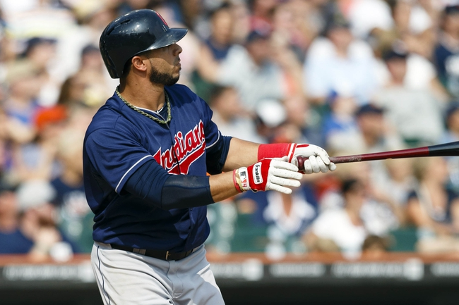 Sep 1, 2013; Detroit, MI, USA; Cleveland Indians third baseman Mike Aviles (4) hits a grand slam home run in the ninth inning against the Detroit Tigers at Comerica Park. Mandatory Credit: Rick Osentoski-USA TODAY Sports