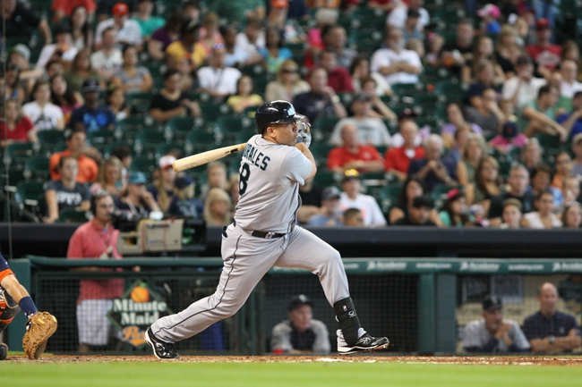 Sep 1, 2013; Houston, TX, USA; Seattle Mariners designated hitter Kendrys Morales (8) bats during the fourth inning against the Houston Astros at Minute Maid Park. Mandatory Credit: Troy Taormina-USA TODAY Sports
