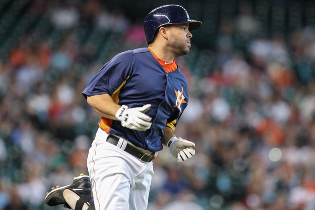 Sep 1, 2013; Houston, TX, USA; Houston Astros second baseman Jose Altuve (27) gets a single during the third inning against the Seattle Mariners at Minute Maid Park. Mandatory Credit: Troy Taormina-USA TODAY Sports