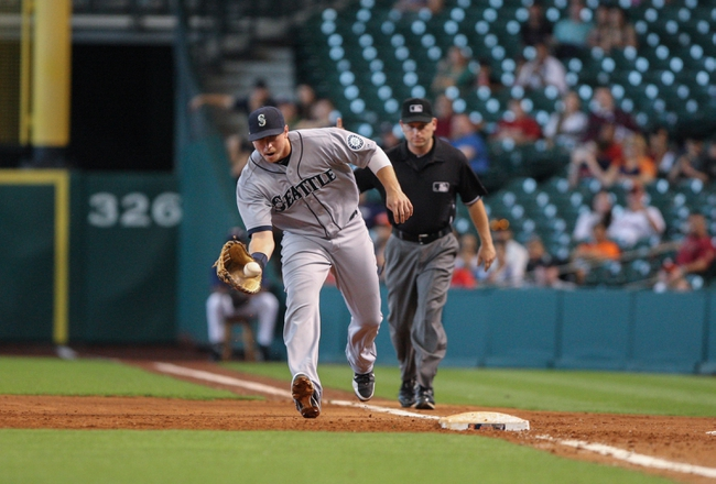 Sep 1, 2013; Houston, TX, USA; Seattle Mariners first baseman Justin Smoak (17) fields a ground ball during the fourth inning against the Houston Astros at Minute Maid Park. Mandatory Credit: Troy Taormina-USA TODAY Sports