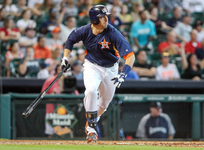 Sep 1, 2013; Houston, TX, USA; Houston Astros catcher Jason Castro (15) drives in a run with a base hit during the eighth inning against the Seattle Mariners at Minute Maid Park. Mandatory Credit: Troy Taormina-USA TODAY Sports