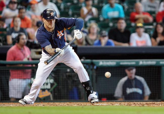 Sep 1, 2013; Houston, TX, USA; Houston Astros center fielder Brandon Barnes (2) successfully executes a suicide squeeze bunt during the eighth inning against the Seattle Mariners at Minute Maid Park. Mandatory Credit: Troy Taormina-USA TODAY Sports