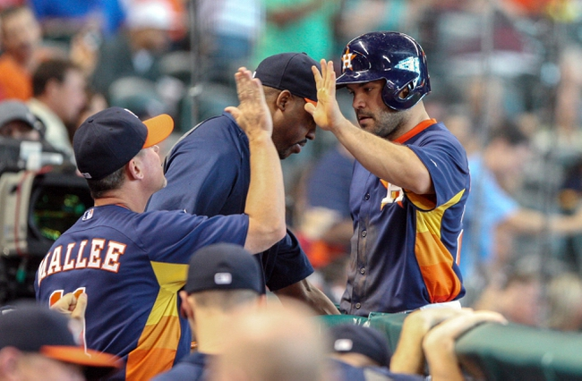 Sep 1, 2013; Houston, TX, USA; Houston Astros second baseman Jose Altuve (27) is congratulated after scoring a run during the eighth inning against the Seattle Mariners at Minute Maid Park. Mandatory Credit: Troy Taormina-USA TODAY Sports