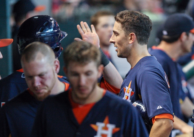 Sep 1, 2013; Houston, TX, USA; Houston Astros catcher Jason Castro (15) is congratulated after scoring a run during the eighth inning against the Seattle Mariners at Minute Maid Park. Mandatory Credit: Troy Taormina-USA TODAY Sports