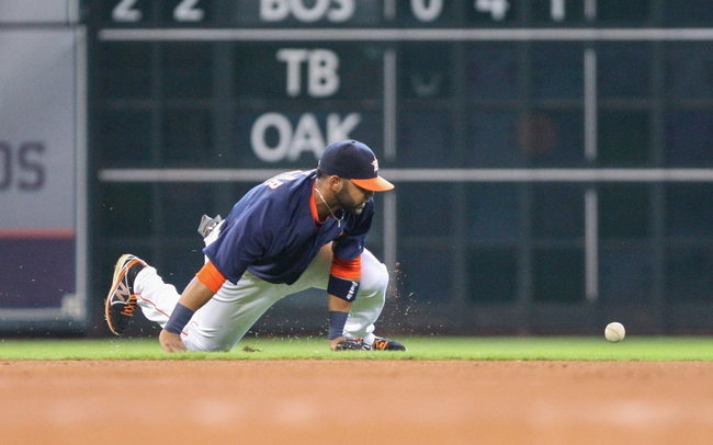 Sep 1, 2013; Houston, TX, USA; Houston Astros shortstop Jonathan Villar (6) attempts to field a ground ball during the fourth inning against the Seattle Mariners at Minute Maid Park. Mandatory Credit: Troy Taormina-USA TODAY Sports
