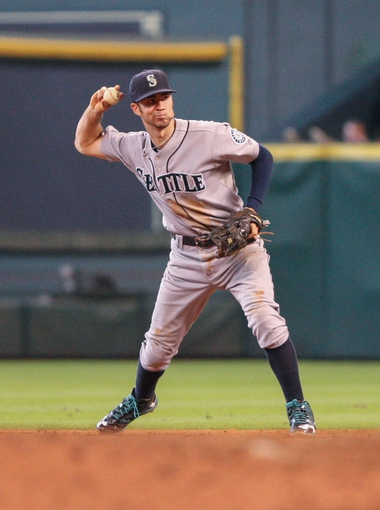 Sep 1, 2013; Houston, TX, USA; Seattle Mariners second baseman Nick Franklin (20) throws to first base during the fifth inning against the Houston Astros at Minute Maid Park. Mandatory Credit: Troy Taormina-USA TODAY Sports