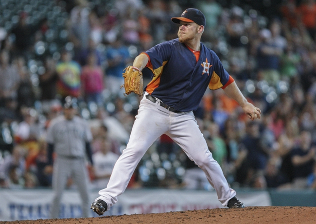 Sep 1, 2013; Houston, TX, USA; Houston Astros starting pitcher Brett Oberholtzer (65) pitches during the ninth inning against the Seattle Mariners at Minute Maid Park. Mandatory Credit: Troy Taormina-USA TODAY Sports