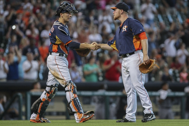 Sep 1, 2013; Houston, TX, USA; Houston Astros catcher Jason Castro (15) congratulates starting pitcher Brett Oberholtzer (65) after Oberholtzer pitches a complete game and the Astros defeat the Seattle Mariners 2-0 at Minute Maid Park. Mandatory Credit: Troy Taormina-USA TODAY Sports