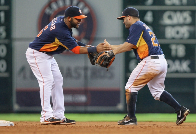 Sep 1, 2013; Houston, TX, USA; Houston Astros shortstop Jonathan Villar (6) and Astros second baseman Jose Altuve (27) celebrate after defeating the Seattle Mariners 2-0 at Minute Maid Park. Mandatory Credit: Troy Taormina-USA TODAY Sports
