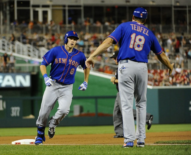 Sep 1, 2013; Washington, DC, USA; New York Mets center fielder Matt den Dekker (6) is congratulated by New York Mets third base coach Tim Teufel (18) after hitting a solo home run during the second inning against the Washington Nationals at Nationals Park.  Mandatory Credit: Brad Mills-USA TODAY Sports