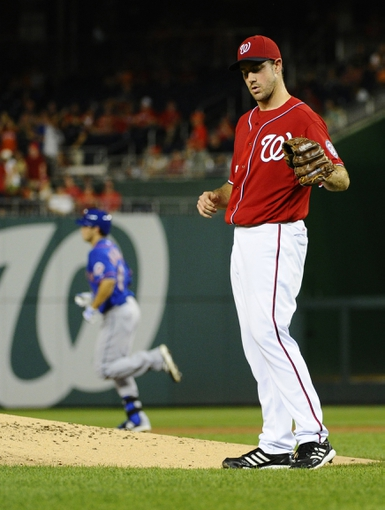 Sep 1, 2013; Washington, DC, USA; Washington Nationals starting pitcher Ross Ohlendorf (43) reacts after giving a solo home run to New York Mets center fielder Matt den Dekker (left) during the second inning at Nationals Park. Mandatory Credit: Brad Mills-USA TODAY Sports