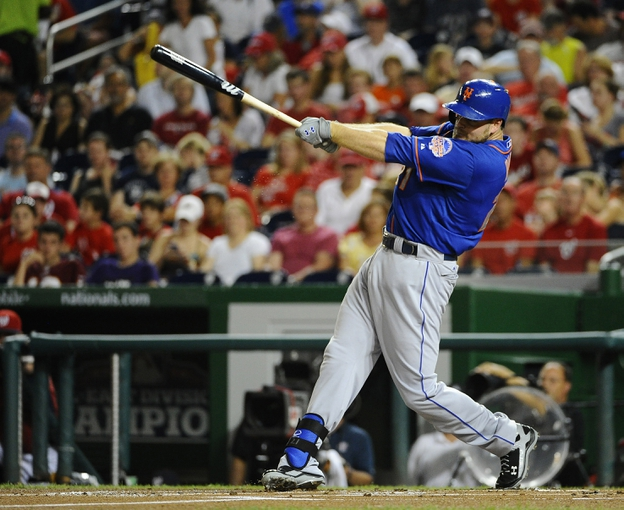 Sep 1, 2013; Washington, DC, USA; New York Mets first baseman Lucas Duda (21) hits an RBI single during the first inning against the Washington Nationals at Nationals Park. Mandatory Credit: Brad Mills-USA TODAY Sports
