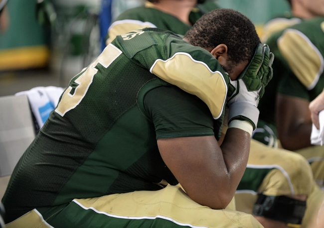 Sep 1, 2013; Denver, CO, USA; Colorado State Rams offensive linesman Brandon Haynes (75) reacts following losing to the the Colorado Buffaloes at Sports Authority Field at Mile High. The Buffaloes defeated the Rams 41-27. Mandatory Credit: Ron Chenoy-USA TODAY Sports