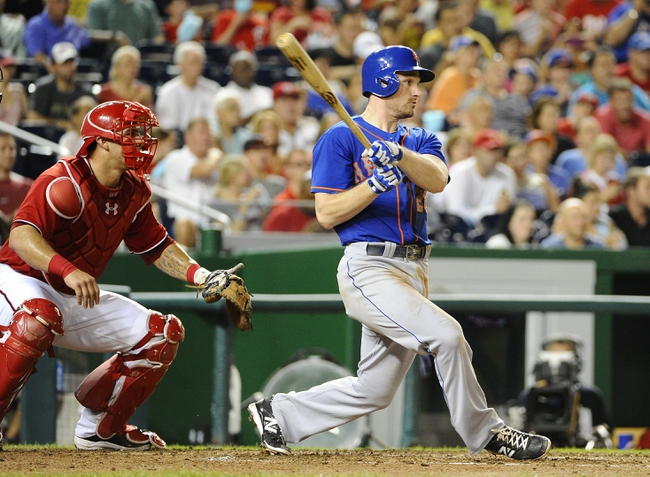 Sep 1, 2013; Washington, DC, USA; New York Mets second baseman Daniel Murphy (28) hits an RBI single during the fifth inning against the Washington Nationals at Nationals Park.  Mandatory Credit: Brad Mills-USA TODAY Sports