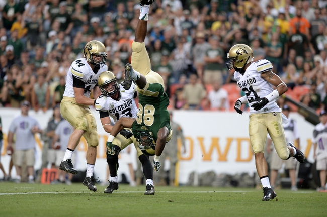 Sep 1, 2013; Denver, CO, USA; Colorado State Rams tight end Kivon Cartwright (86) is flipped upside down going for a reception while Colorado Buffaloes linebacker Addison Gillam (44) and defensive back Parker Orms (13) and defensive back Jered Bell (21) observe during the game at Sports Authority Field at Mile High. Mandatory Credit: Ron Chenoy-USA TODAY Sports