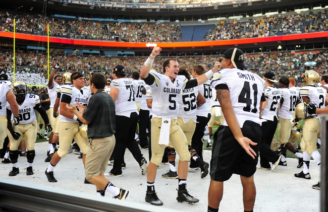 Sep 1, 2013; Denver, CO, USA; Colorado Buffaloes quarterback Connor Wood (5) (center) reacts during the game against the Colorado State Rams in the fourth quarter at Sports Authority Field at Mile High. The Buffaloes defeated the Rams 41-27. Mandatory Credit: Ron Chenoy-USA TODAY Sports