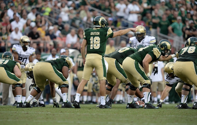 Sep 1, 2013; Denver, CO, USA; Colorado State Rams quarterback Garrett Grayson (18) at the line of scrimmage during the game against the Colorado Buffaloes Sports Authority Field at Mile High.The Buffaloes defeated the Rams 41-27. Mandatory Credit: Ron Chenoy-USA TODAY Sports
