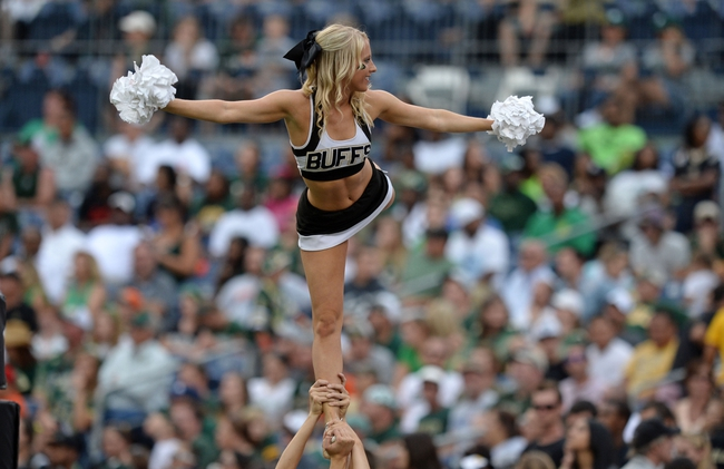 Sep 1, 2013; Denver, CO, USA; Colorado Buffaloes cheerleader performs during the game against the Colorado State Rams in the fourth quarter at Sports Authority Field at Mile High. The Buffaloes defeated the Rams 41-27. Mandatory Credit: Ron Chenoy-USA TODAY Sports
