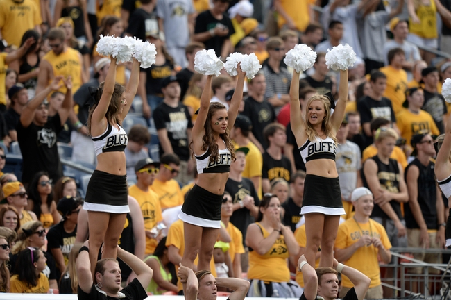 Sep 1, 2013; Denver, CO, USA; Colorado Buffaloes cheerleaders perform during the game against the Colorado State Rams in the fourth quarter at Sports Authority Field at Mile High. The Buffaloes defeated the Rams 41-27. Mandatory Credit: Ron Chenoy-USA TODAY Sports