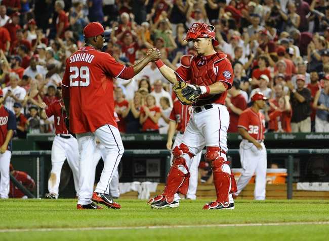 Sep 1, 2013; Washington, DC, USA; Washington Nationals relief pitcher Rafael Soriano (29) is congratulated by Washington Nationals catcher Wilson Ramos (40) after earning the save against the New York Mets at Nationals Park. Mandatory Credit: Brad Mills-USA TODAY Sports