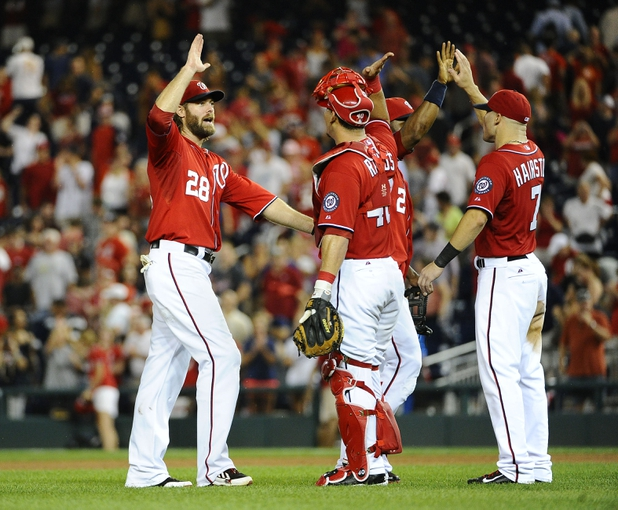 Sep 1, 2013; Washington, DC, USA; Washington Nationals right fielder Jayson Werth (28) celebrates with Wilson Ramos (40) and Scott Hairiston (7) after defeating the New York Mets at Nationals Park. Mandatory Credit: Brad Mills-USA TODAY Sports