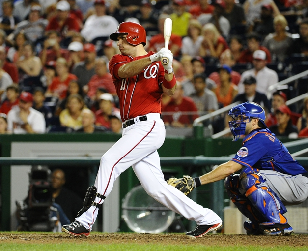 Sep 1, 2013; Washington, DC, USA; Washington Nationals third baseman Ryan Zimmerman (11) hits an RBI single during the eighth inning against the New York Mets at Nationals Park. Mandatory Credit: Brad Mills-USA TODAY Sports