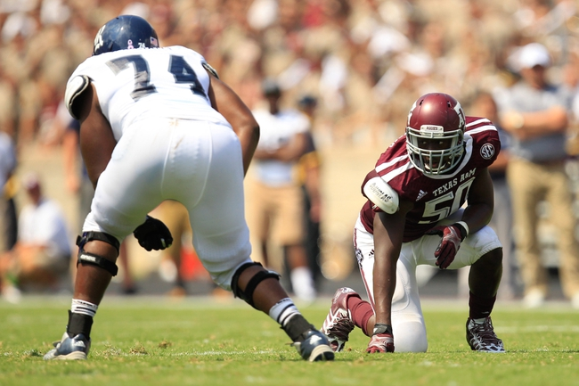 Aug 31, 2013; College Station, TX, USA; Texas A&M Aggies linebacker Tyrone Taylor (50) sets up against Rice Owls offensive linesman Caleb Williams (74) during the second half at Kyle Field. Texas A&M won 52-31. Mandatory Credit: Thomas Campbell-USA TODAY Sports