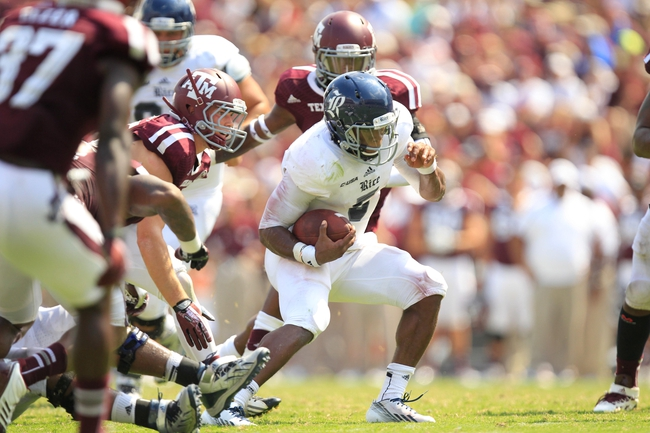 Aug 31, 2013; College Station, TX, USA; Rice Owls quarterback Driphus Jackson (5) scrambles against the Texas A&M Aggies during the second half at Kyle Field. Texas A&M won 52-31. Mandatory Credit: Thomas Campbell-USA TODAY Sports
