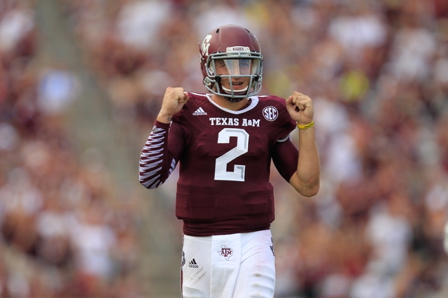 Aug 31, 2013; College Station, TX, USA; Texas A&M Aggies quarterback Johnny Manziel (2) celebrates throwing a touchdown against the Rice Owls during the second half at Kyle Field. Texas A&M won 52-31. Mandatory Credit: Thomas Campbell-USA TODAY Sports