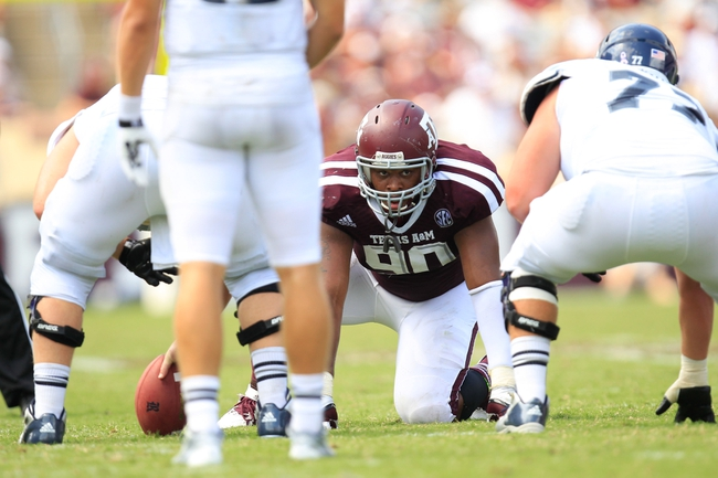 Aug 31, 2013; College Station, TX, USA; Texas A&M Aggies defensive lineman Alonzo Williams (90) sets up against the Rice Owls during the second half at Kyle Field. Texas A&M won 52-31. Mandatory Credit: Thomas Campbell-USA TODAY Sports